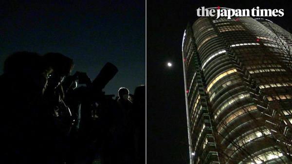 People in Tokyo observe super blue blood moon at Roppongi Hills' Sky Deck rooftop